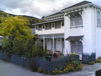 Amber House B&B tourist lodging in Nelson, New Zealand from the North West in late winter 2005. The centre of New Zealand is visible above the 