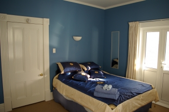Photo of the  upstairs Balcony Suite at the North East wing of Amber House showing the Queen sized bed with an Orthopaedic  mattress