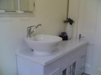 The Balcony Suite's private bathroom at AMBER HOUSE Bed and Breakfast tourist lodgings, Nelson, New  Zealand